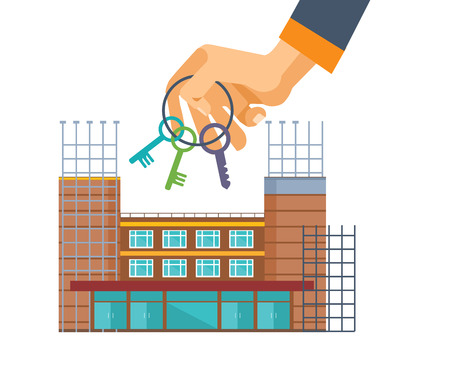 Real estate agency. Hand with keys on background construction houses.