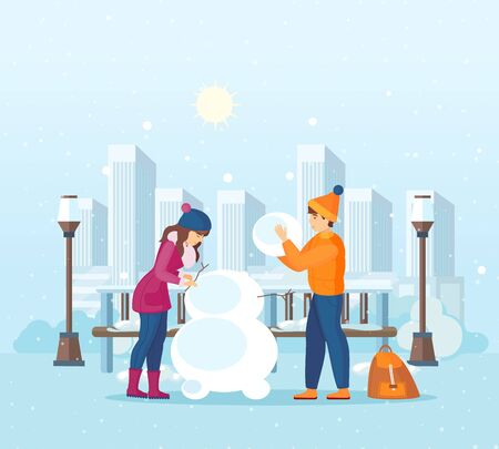 Couple of young man and woman sculpt snowman.