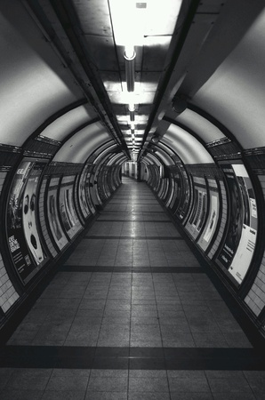 tunnel vision: Empty and eerie underground station tunnel in the city of London Embankment Stock Photo