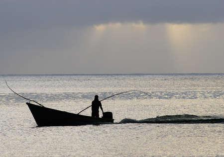 fishman: silhouette of fast sailing boat