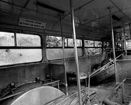wrech: A black & white from inside an old bus wreck.