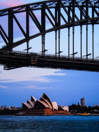 sydney opera house and sydney harbour bridge in the evening