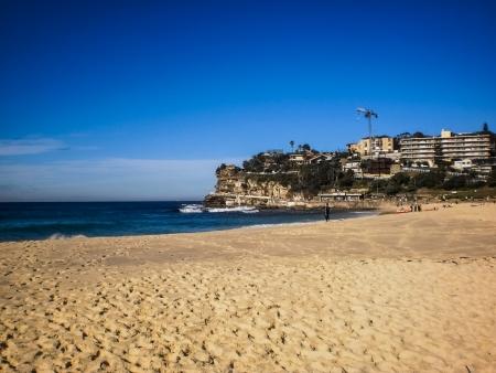 Blue sky with white sand at Bondi beach Stock Photo