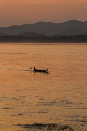 Boat racing team practice at Mekong river photo