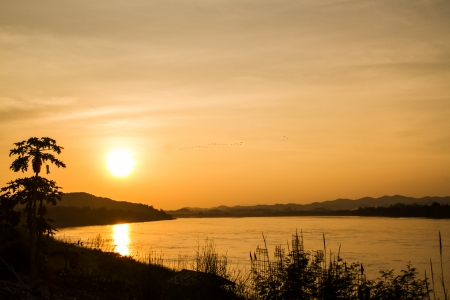 Sunset at Mekong river bwtween Thailand and Loas photo