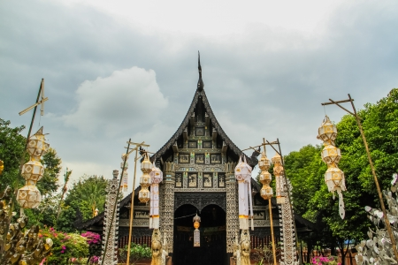 antique wooden temple with yipeng festival decoration in Chiang mai of Thailand photo