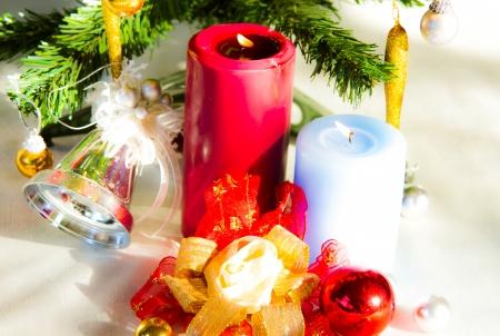 christmas candle decoration under christmas tree on christmas day photo