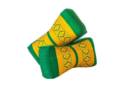 Green and yellow Thai design pillow with white background photo
