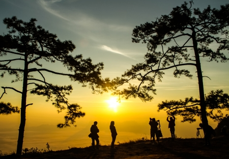 sunrise at the mountain view with a group of people