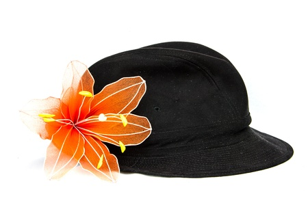 black velvet hat with orange flower on white background photo