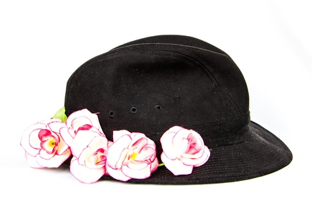 black velvet hat with pink rose on white background photo
