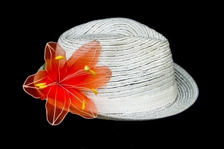 white elegance and  classic hat with flowers  on black background photo