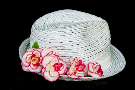 white elegance and  classic hat with pink roses on black background photo