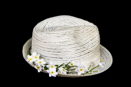 white elegance and  classic hat with white flowers on black background photo