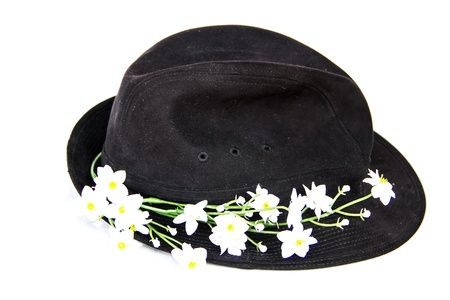 black velvet hat with white flowers on white background photo