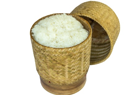 cooking ware: sticky rice in bamboo container on white background