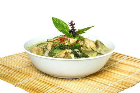 Thai green curry  ready for serve on bamboo wrap photo