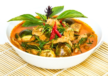 red curry ready for serve on bamboo wrap