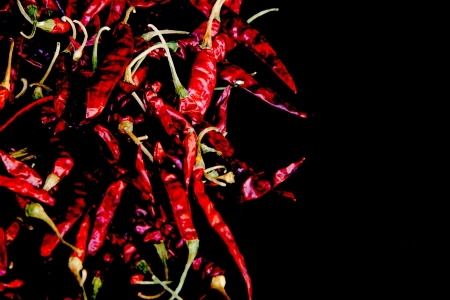 red dry and hot chilli on black background