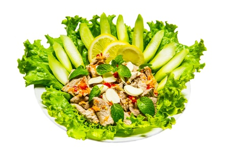 Thai spicy pork salad on white background photo