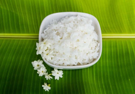 rice field: white jasmine rice on green  banana leaf Stock Photo