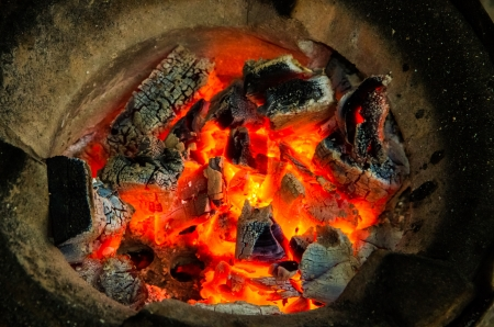 burning charcoal in stove ready for cooking