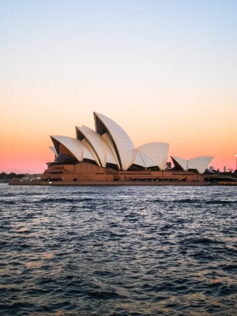 Sydney opera house with pink and yellow sky