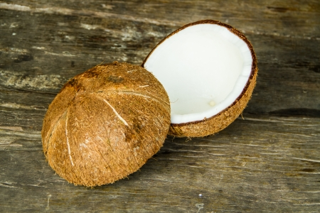 Half cut of coconut on wood background photo