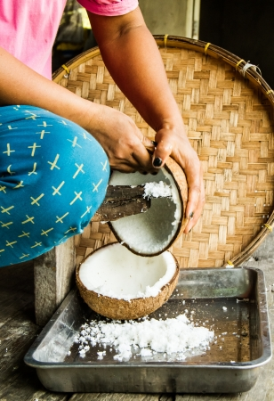 old style coconut milk making by hand photo
