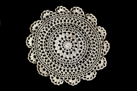 white dish altar knitting on black background Stock Photo - 19649647
