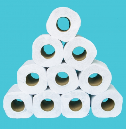 Clean white tissue paper rolls on blue background photo