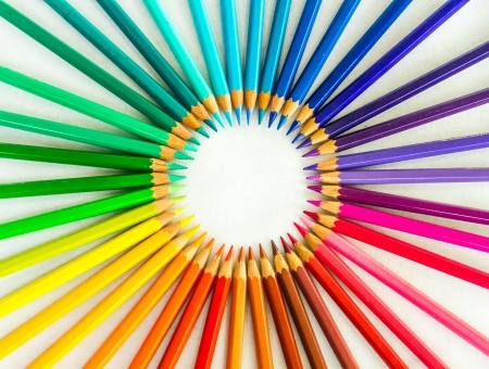 white bacground: Colour pencils in circle sign on white bacground Stock Photo