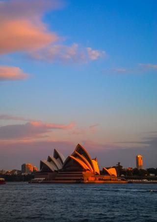utzon: SYDNEY-SEPTEMBER 17   Sydney opera house  with colorful sky in Sydney,Australia on 17 September 2012  It was designed by Danish architect Jorn Utzon
