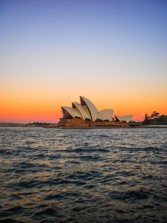 utzon: SYDNEY-APRIL 25 Sydney opera house  on colorful sky  in Sydney,Australia on 25 April 2012  It was designed by Danish architect Jorn Utzon