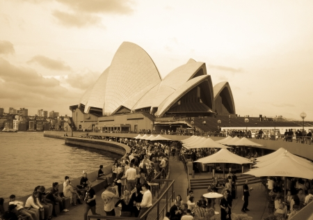 utzon: SYDNEY-SEPTEMBER 18   Party people at Sydney opera house  in antique tone at  Sydney,Australia on 18 September 2012  It was designed by Danish architect Jorn Utzon  Editorial