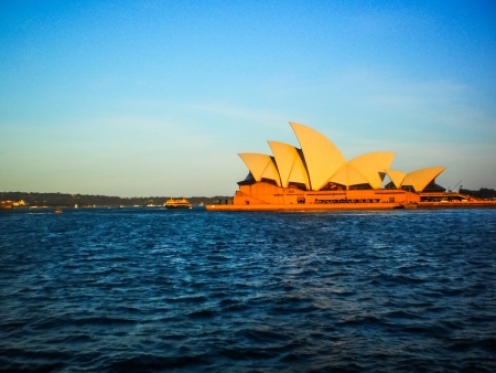 utzon: SYDNEY-NOVEMBER 11   Sydney opera house with blue sky in  Sydney,Australia on 11 NOVEMBER 2012  It was designed by Danish architect Jorn Utzon