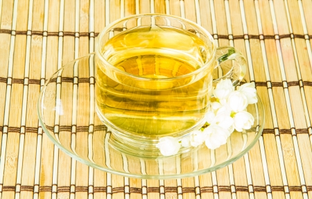 a cup of jasmine tea on bamboo wrap photo