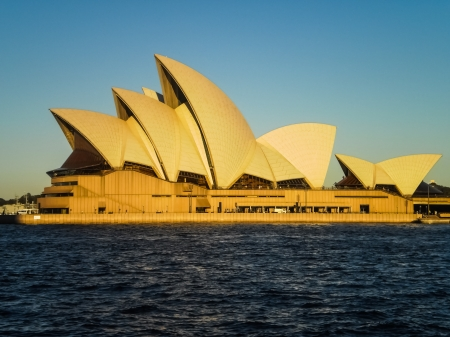 utzon: SYDNEY-APRIL 25 Sydney opera house  on blue sky  in Sydney,Australia on 25 April 2012  It was designed by Danish architect Jorn Utzon