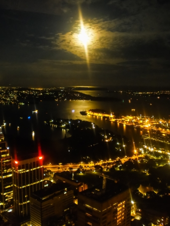 Light of Sydney city in the evening with full moon