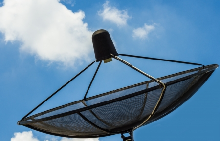 Satellite TV receiver on blue sky background. photo