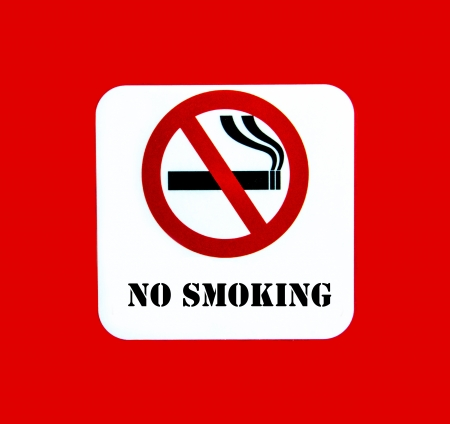 No smoking sign on the red background photo