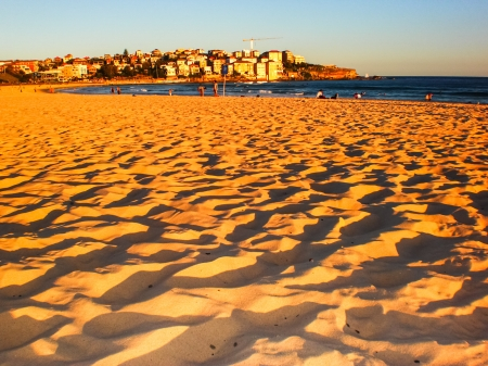 golden sand at Bondi beach ,Sydney in late afternoon.