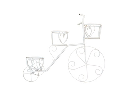 White decor bicycle on the white background  photo