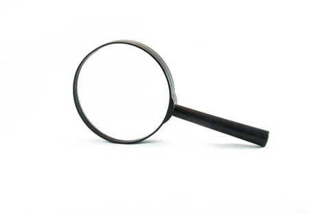 Magnifying glass on the white background . photo