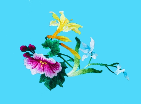 Silk flower sewing by hand on blue background