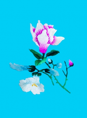 lappet: Silk flower sewing by hand on blue background
