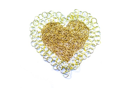 Golden chain in the heart sign on white background  photo