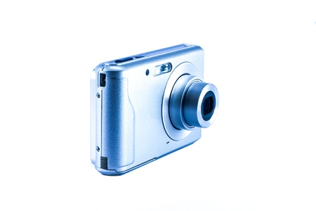 Compact digital camera on the white background. photo