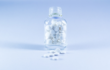 White medicines in the Transparent bottle .