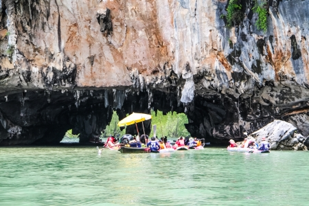 Tourist enjoy kayaking through the cave